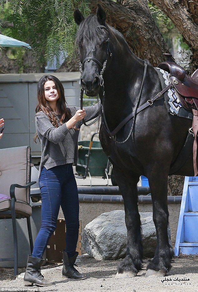 selena gomez horsing around 2014