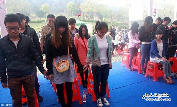 طالبة صينية تقيم بروفة لجنازتها